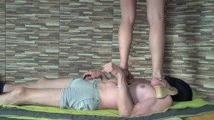 very cruel wedges trampling stomping jumping and stands on head of a slave